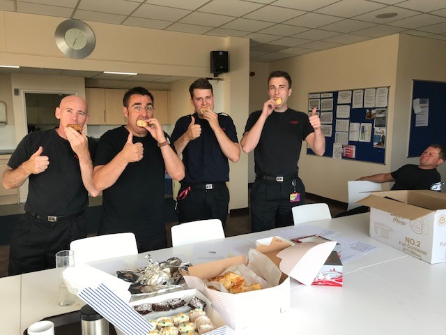 Firefighters at Canterbury station enjoy treats baked for them by The Canterbury Academy pupils